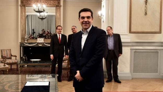 The head of Greece's far-left Syriza party, Alexis Tsipras, is sworn in as prime minister and is set to lead an anti-austerity coalition.