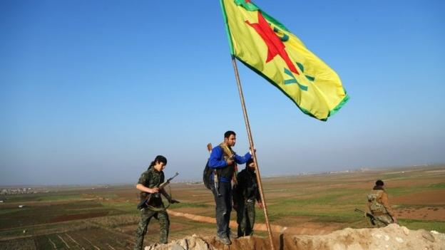 Kurdish forces have driven Islamic State (IS) militants from of Kobane, activists say, ending a four-month battle for the northern Syrian town.