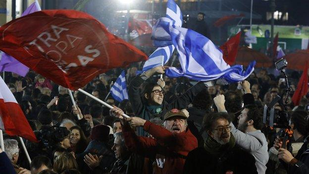 The German government warns Greece that it must meet its commitments to lenders, after the election win of the Greek anti-austerity Syriza party.
