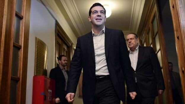 New Greek PM Alexis Tsipras tells his first cabinet meeting his country will not default on its bailout debts, but will negotiate with creditors.