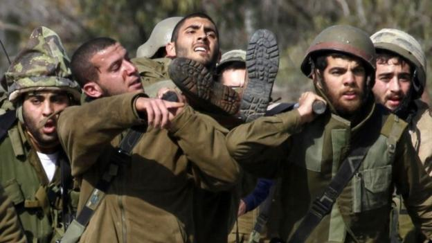Two Israeli soldiers and a Spanish UN peacekeeper are killed as Hezbollah militants trade fire with Israeli forces along the Lebanese border.