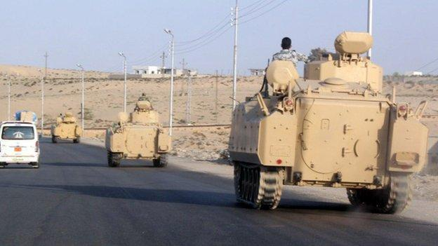 At least 25 people, including soldiers, are killed in a series of attacks by suspected Islamist militants in Egypt's Sinai peninsula, state TV says.