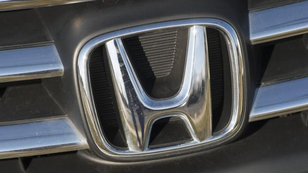 Japanese carmaker Honda cuts its profit forecast and sees third quarter earnings drop sharply following a vehicle recall linked to airbags.