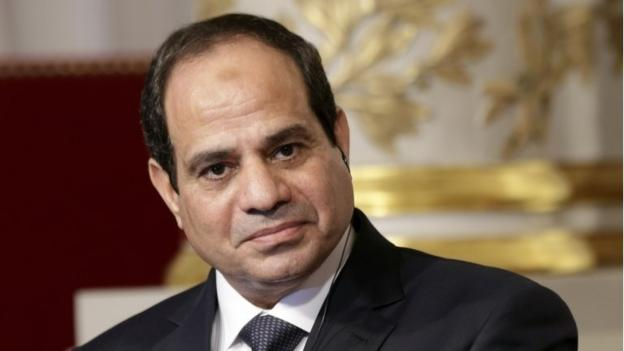 Egyptian President Abdul Fattah al-Sisi cuts short a visit to an African Union summit to deal with attacks that killed at least 26 in the Sinai peninsula.