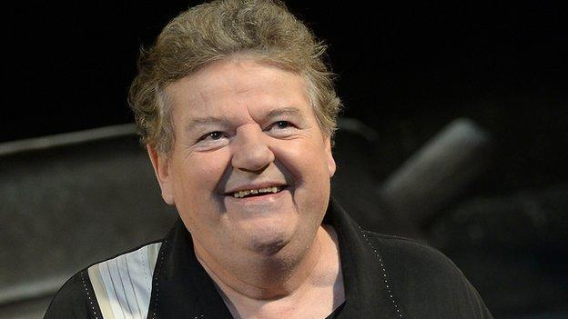 Harry Potter actor Robbie Coltrane is admitted to hospital in Florida with flu-like symptoms after falling ill during a flight from London.