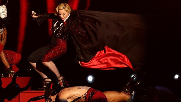 US pop star Madonna fell off the stage during her performance at the 2015 Brit Awards on a night that saw Sam Smith and Ed Sheeran each win two prizes.