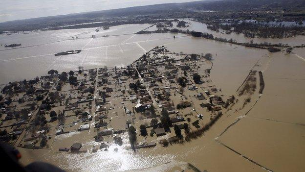 People affected by river flooding worldwide could triple by 2030, with climate change and population growth the main factors, says a new report.