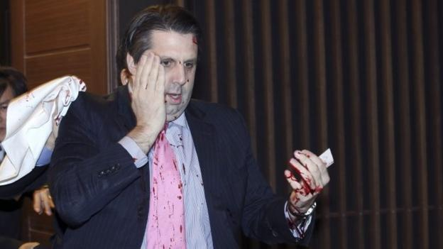 A militant Korean nationalist slashes the face of the US ambassador to South Korea, Mark Lippert, at a breakfast meeting in Seoul.