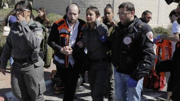 A Palestinian man drives into a group of pedestrians in Jerusalem, injuring four Israeli policewomen and another bystander.
