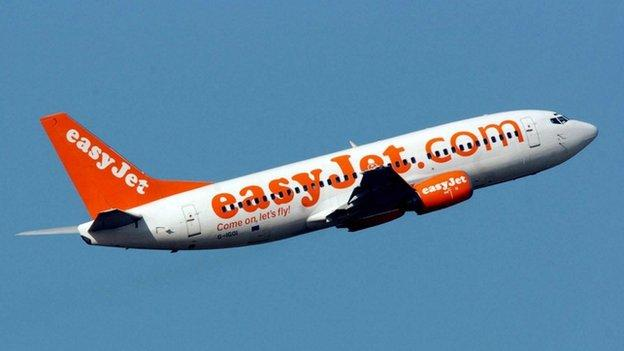 Budget airline Easyjet says it will require two crew in the cockpit at all times, after UK airlines are told to review procedures following the Alps crash.