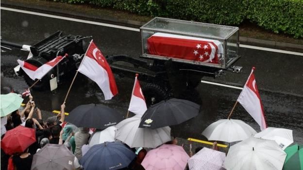 Tens of thousands line the streets in torrential rain in Singapore to see the funeral procession of founding Prime Minister Lee Kuan Yew.
