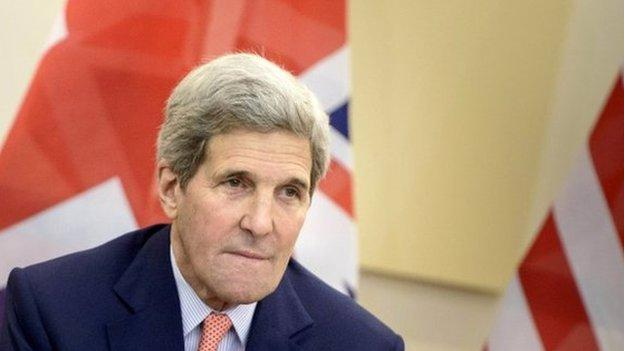 US Secretary of State John Kerry cancels a planned return to the US to stay in Switzerland as the Iran nuclear talks approach their deadline.