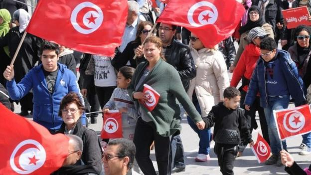 Thousands march in Tunis over the Bardo Museum terror attack, as authorities say that one of the raid's leaders has been killed.