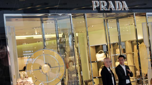 Italian luxury goods retailer Prada sees its net profit fall 28% last year as sales slumped in major markets of China and Europe.
