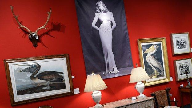A two-day auction of art, jewellery, furniture and clothing owned by the late actress Lauren Bacall raises $3.64m (£2.45m) in New York.