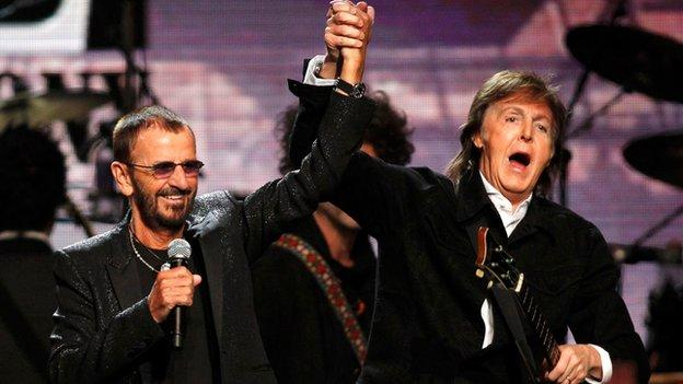 Former Beatles drummer Ringo Starr is joined by Sir Paul McCartney as he is inducted into the Rock and Roll Hall of Fame.