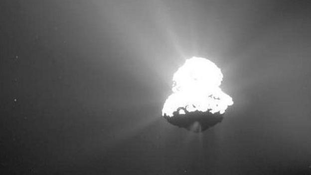 Europe's Rosetta probe catches its comet quarry in the act of producing a huge jet of gas and dust.