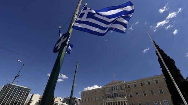 The Greek government asks public sector bodies to hand over any reserve cash to help it meet a payment due to the International Monetary Fund.