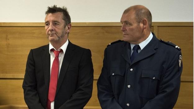 Phil Rudd, drummer with Australian hard rock group AC/DC, unexpectedly pleads guilty at a New Zealand court to making a threat to kill.