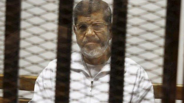 Egypt's former President Mohammed Morsi gets a 20 year jail sentence over the killing of protesters in 2012, the first verdict in several trials he is facing.
