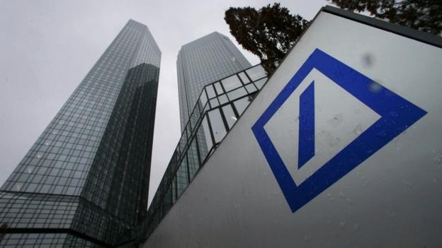 Deutsche Bank reports a sharp fall in profits after setting aside €1.5bn to cover legal costs, days after being fined €2.3bn for rate rigging.