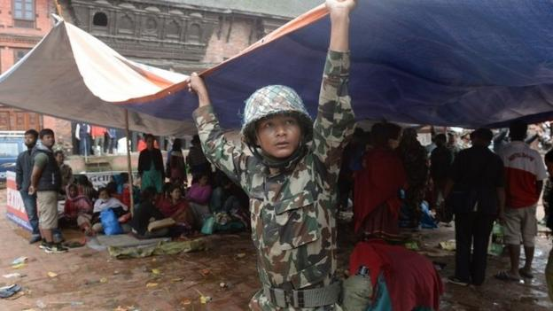 Tent cities spring up in the Nepalese capital after Saturday's earthquake, which is now reported to have killed some 2,500 people.