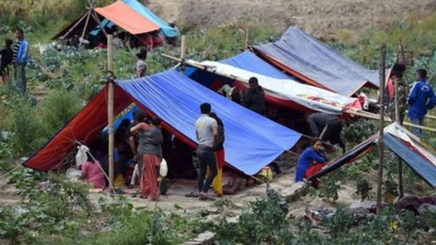 Vast tent cities spring up in the Nepalese capital after Saturday's earthquake, which is now reported to have killed some 2,500 people.