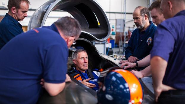 Land-speed record-holder Andy Green sees the installation of the seat he will use in the 1,000mph Bloodhound Super Sonic Car.