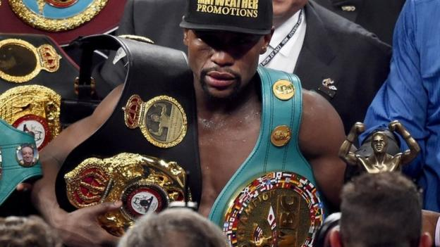 Floyd Mayweather beats Manny Pacquiao on points to maintain his unbeaten record and win the richest fight in boxing history.