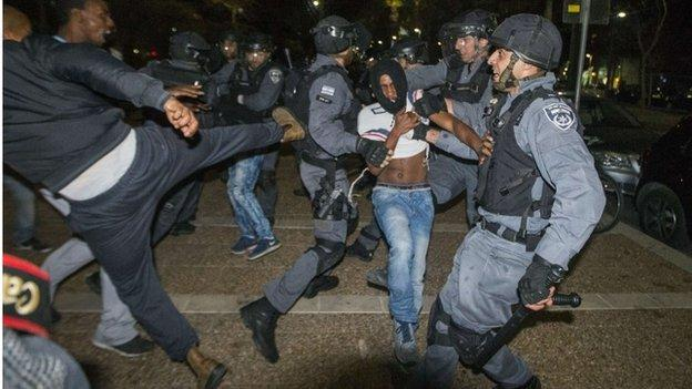 "Israel's president says Ethiopian Israelis' protests against alleged discrimination ""revealed an open and raw wound"" at the heart of Israeli society."