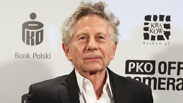 Director Roman Polanski is given one of Poland's top film awards in Krakow, where he also faces a US request to extradite him over rape charges dating back to 1977.