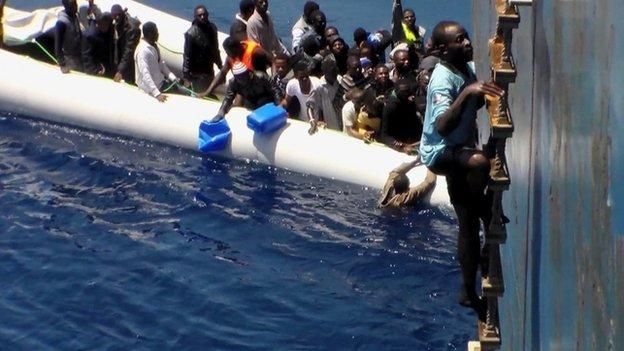 Dozens of migrants have drowned in the Mediterranean after a boat deflated south of Sicily, Save the Children says.
