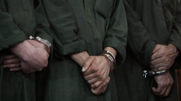 Four men are sentenced to death in Afghanistan over the mob killing of a woman falsely accused of burning the Koran.