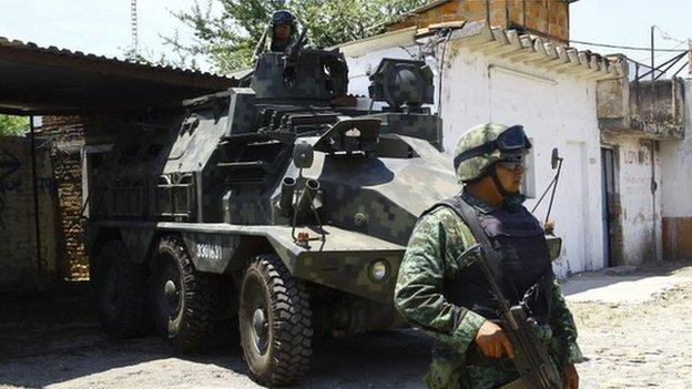 At least 43 people are killed in a gunfight between security forces and an armed gang in one of Mexico's most violent states.