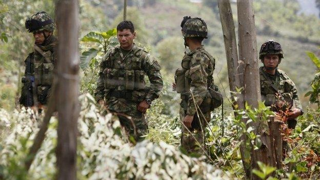 Colombian Farc leftist rebel group suspends its unilateral ceasefire following army attack in which 26 fighters died.