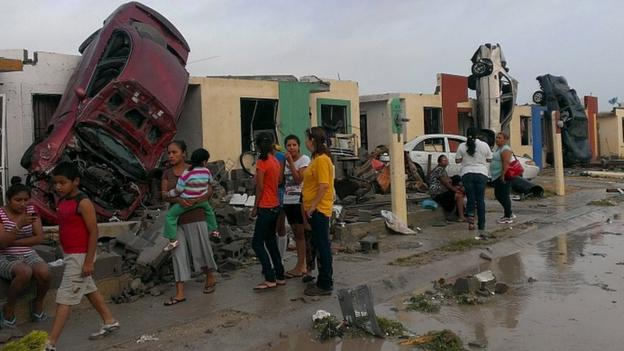 At least 13 people have been killed and hundreds of houses destroyed or damaged as a tornado strikes Mexico's Ciudad Acuna.