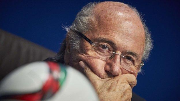 Fifa president Sepp Blatter chairs an emergency meeting under growing political pressure over a corruption scandal that began on Wednesday.