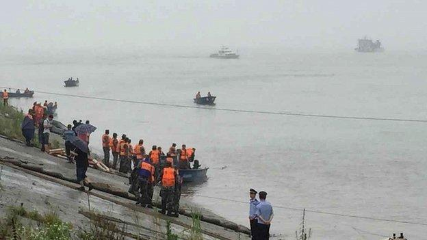 A ship carrying more than 450 people sinks during a storm on the Yangtze River in southern China, state media say.