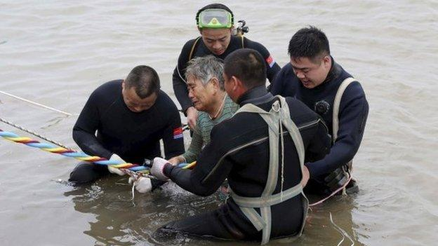 Five people are dead and hundreds are missing after a cruise ship with more than 450 people, mostly elderly tourists, capsizes on China's Yangtze River.