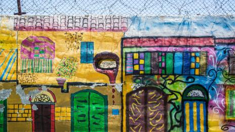 Graffiti on a wall between the Greek and Turkish sectors of Nicosia, Cyprus (Credit: Credit: Carl Hanninen/Alamy)
