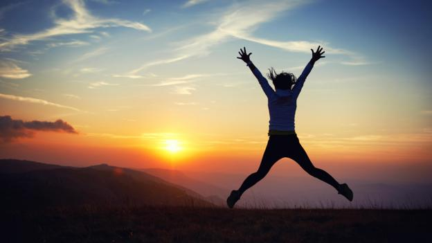 Woman jumping at sunset (Credit: Alamy)