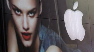 Apple logo reflected in a clothes store window (Copyright: Getty Images)