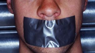 Man with tape on his mouth (Copyright: Thinkstock)