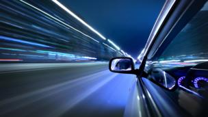 Car streakign past lights (Copyright: Thinkstock)