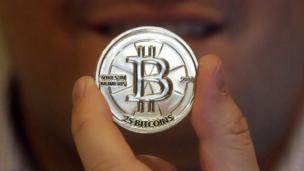 Bitcoin token held by its creator, software engineer Mike Caldwell (Copyright: AP)