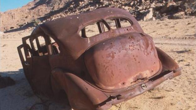 Broken wrecked car rusting away in Namibia, Africa