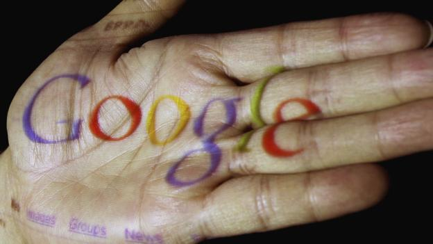 Google logo projected on to a hand (Copyright: Getty Images)