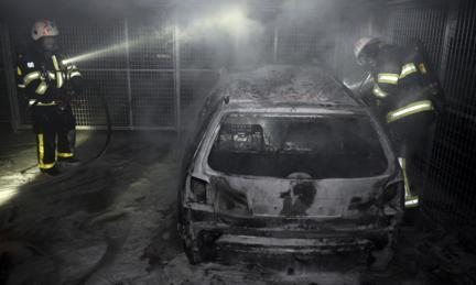 Car burned out by rioters