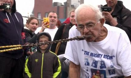92-year-old Mike Greenstein pulls a car with his teeth.