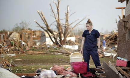 Dana Ulepich looks at the debris from her house destroyed by a powerful tornado ripped through the area on May 20, 2013 in Moore, Oklahoma.